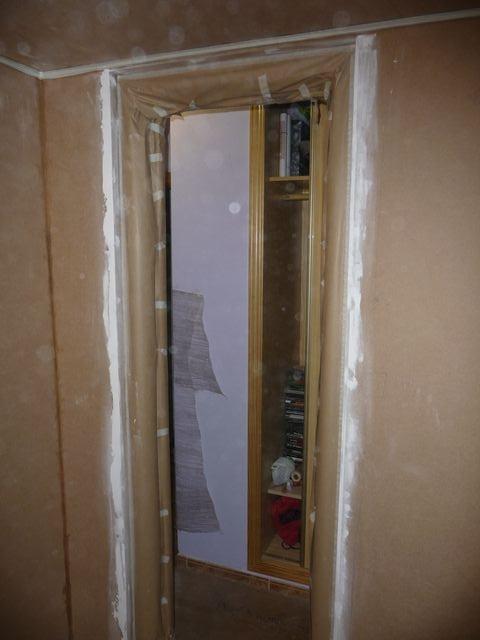 tapando marco puerta cinta carrocero